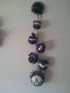 Palle di Natale a cascata realizzate con la tecnica del patchwork senz'ago