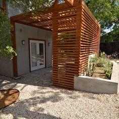 wood slats and pergola for entry privacy