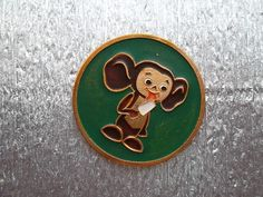 Big very rare soviet pin badge Cheburashka eating ice cream a character of children Russian cartoon. Made in the USSR.
