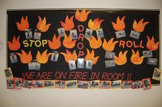 This was one of my favorite bulletin boards for October, National Fire Safety Month. The students sponge painted their flames. I took pictures of the students posing in stop, drop, and roll position.