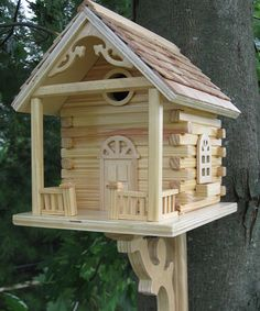 This lovely little birdhouse would definitely need a metal portal ring so a squirrel would not chew a larger opening to make it home!
