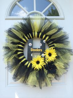 Steelers tulle wreath! Used tulle wreath tutorial then added an H for our last name and used Steelers duct tape to cover the letter. We are ready for football season!