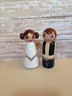 The set includes my tribute to Princess Leia and Han Solo. They stand approx. 3.5 inches tall and these are the perfect decorations for a Star Wars fan or are a fun way to let your inner geek show as toppers for a birthday or wedding cake. Just let me know if you would like to add more characters to the set!  The last set shows a couple as wedding cake toppers on a base. Check out my Wedding section to see all of the bases I offer that these little guys could sit on and add one to your cart…