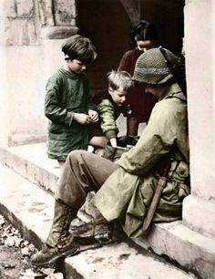 French children and U.S. Soldier, Carentan, Manche, France 15 June 1944.