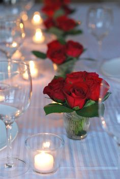 Maybe put in shorter mason jars? Red and yellow roses with pink rosebuds(from Costco $17 for 2 dozen) greens, baby's breath?