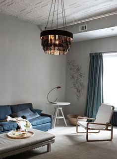 This classic SoHo loft was transformed into a contemporary and stylish space by design company Ochre. Soft, moody, muted and understated elegance. Click through to see more. http://designpilgrim.com.au/portfolios/softly-soho