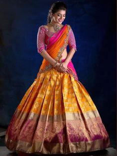 Check out this brand which have the best South Indian bridal wears like half sarees and silk sarees. Lehenga Saree Design, Half Saree Lehenga, Pattu Saree Blouse Designs, Bridal Blouse Designs, Indian Lehenga, Saree Look, Lehenga Designs, South Indian Blouse Designs, Brocade Lehenga