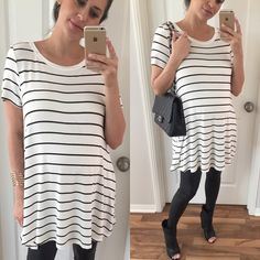 "S A L E \ White & Black Striped Top • Item Information: Such a cute cute go to! A soft white and black striped loose top. Fits loose throughout the body. 95% rayon 5% spandex. Medium: 31"" long • 19"" chest • Body is open. * Also in reversed colors- black and white stripes *   • Size I'm modeling: Medium  • Sizes available: Medium, Large Tops Tees - Short Sleeve"