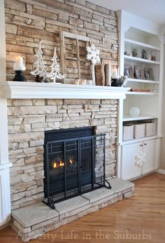 I want to remove the white trim around our fireplace, put up faux stone up to mantle and. Sit back and enjoy! A Pretty Life In The Suburbs stone fireplace surround.