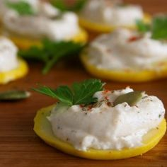 Squash slices topped with garlic & herbs macadamia nut cheese. {raw & vegan}