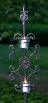 "Clarity Candle Holder - Spirit Stakes™ Candle holders add a dramatic focal point for entertaining outdoors with ""flare""! This Clarity Candle Holder is crafted in durable hand-forged iron, the stakes come apart for easy shipping, assembly and storage. 8 1/2"" W, 72"" H. As part of the Spirit Stakes Collection you can create unique garden structures and encourage climbing plants by combining with a Hoop or Heart trellis – sold separately. Designed to patina to a natural rust finish. Garden"