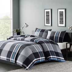 The bold print of this Ink Ivy Nathan Duvet Cover Mini Set uses black, white and a pop of blue thread woven together to create a dark grey and light grey plaid pattern. The set includes at least one sham.