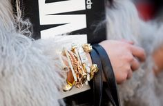 Arm party essentials: skulls, leather and gold.