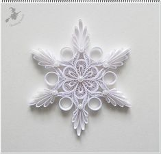 Paper quilling snowflake workshopsLearn how to paper Quill Snowflakes during Christmas with unique tools, glues and shapes! Paper Quilling is such a wonderful paper craft that you will be amazed by this ornament! Paper Quilling Tutorial, Paper Quilling Flowers, Paper Quilling Patterns, Origami And Quilling, Quilled Paper Art, Quilling Paper Craft, Paper Crafts, Origami Flowers, Diy Christmas Snowflakes