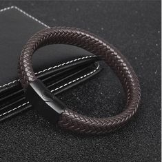 Black/Brown Braided Leather Bracelet for Men. Take a look at this leather bracelet for men, which you can wear with different outfits and different events Jewelry Stores Near Me, Bracelets For Men, Leather Bracelets, Fashion Bracelets, Fashion Jewelry, Braided Leather, Stainless Steel Bracelet, Leather Men, Leather Jackets