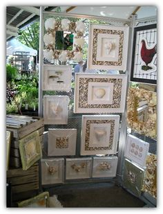 "This is part of my Summer Display at the Ann Arbor Farmers Market which includes ""Seashell Mirrors"" and other wall decor. One of my best sellers is the ""French Provance Hen"" in the upper right hand corner."
