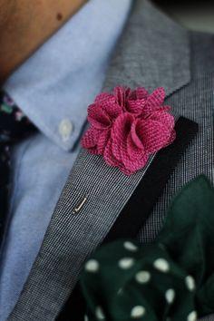 Blazer with navy trim, blue oxford shirt, floral tie, green tie clip, pink lapel flower, green polka dot pocket square