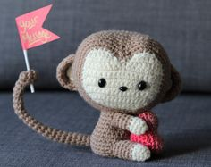 Kawaii baby monkey amigurumi with fun poseable paws and tails that can grasp small objects! Perfect for a baby born in the Zodiac year of the Monkey!  Based on pattern by: AllAboutAmi