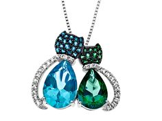 From our 'Rainbow Topaz' Collection: Cat companions in paraiba blue and rainforest green topaz.
