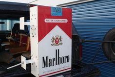 HUGE Marlboro Cigarette Advertising Display.This is a very large industrial Marlboro Advertising Display that would have been hung on the outside of a store. Dimensions are approx 3ft tall by 2ft wide. This is complete replica of the iconic cigarette pack complete with the health warning. Price is just $225