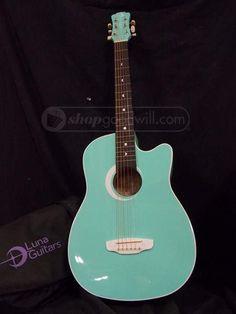 Aqua guitar www.shopgoodwill.com