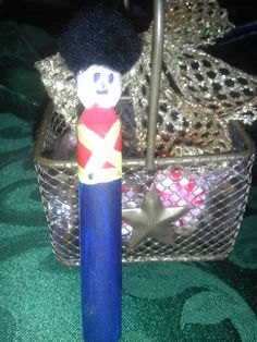 Nutcracker Party Favors-hand painters clothes pins to be used as chip clips, pinned to a basket filled with spiced nuts and peppermint candies. FUN!