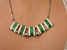 Art Deco Fringe Necklace by BENGEL.  +++  Early 1930's Jakob Bengel modernist fan fringe necklace in chrome and green and cream galalith. It measures 20 inches (52cm) from clasp to clasp.