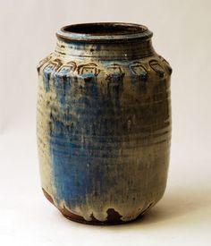 Gutte Eriksen, own studio, Denmark    earthenware vase with pale blue and milky white glaze