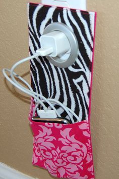 I like this idea for when I go out of town and need to charge my phone; it's a great way to make sure you don't forget your charger because it certainly stands out! I would like to make one myself with different fabric designs :)