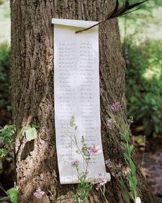Seating Scroll: A Sherwood Forest feeling by pinning a seating scroll to a tree, a la Robin Hood. [♥]