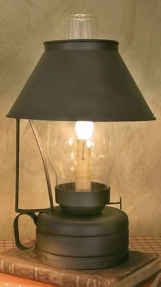This is a reproduction of an antique oil lamp that will add a warm glow to any area that needs a lift of light.  $51.00