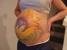 when i was pregnant my boyfriend painted my belly and we took pictures!