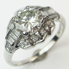 Between the Lines: A scintillating center diamond is bracketed by a bar of crisp baguettes, for a nicely contrasting study in sparkle.  Ca. 1938. Maloys.com