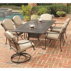 Turn your patio into nature's dining room with this contemporary seven-piece dining set. Constructed of cast aluminum, the set includes cushioned chairs for comfortable dining and an umbrella-ready table with ample serving space. $1931