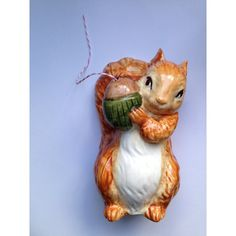 Vintage French ceramic squirrel string holder by GalabeerandtheDog, on Etsy. £30.   https://www.etsy.com/uk/listing/205871136/vintage-french-ceramic-squirrel-string?ref=shop_home_active_4