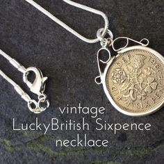Make a fashion statement with this vintage British Lucky Sixpence Sterling Silver Pendant Necklace. Genuine original British coin.