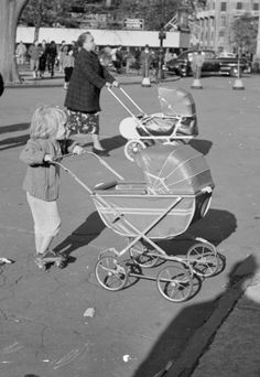 1955: A little girl on roller skates pushes a toy stroller through Washington Square, New York. (Photo by Ernst Haas/Ernst Haas/Getty Images)