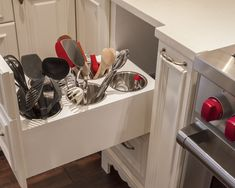 I LOVE, LOVE, LOVE this idea for storing everyday use kitchen. This is a genius organizational solution to keep the counter tops clear from clutter.