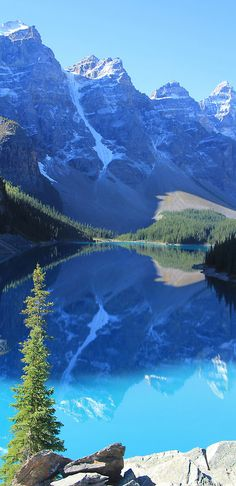Blue pool of Moraine Lake blue sky water nature mountains rocks lake view reflection mirror seasons