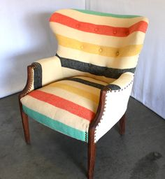 Antique chair with Pendleton style camp blanket upholstery and nail head trim from MODERNHAUS