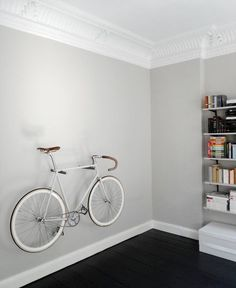 My client doesn't have a car so she uses her bike to get to work and school; hanging her bike on the wall transforms it from being her only source of transportation to a unique piece of art and decoration.