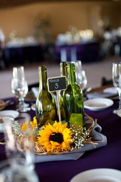 Winery Wedding Details~ Love the wine bottle centerpieces!! Half your tables with low centerpieces and half with tall!!