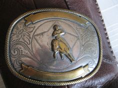 I am a sucker for vintage buckles..... (Cowboy Belt Buckle by MerryJunksters on Etsy)