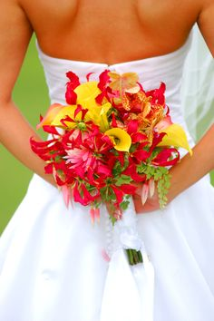 Sunset wedding bouquet. Yellow, red and orange. By Floral Poetry