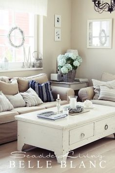 Grey walls, white floors & accents with tan furniture covers