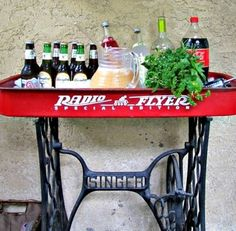 Now, I know what I'll do with that old Radio Flyer wagon I found out at our property.  Make a cute table for our sunporch (minus the sewing machine base).