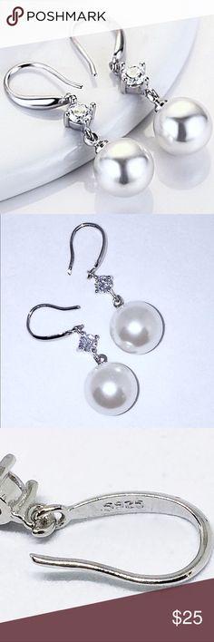 925 Silver 12mm Freshwater Pearl and CZ Earrings 925 Silver 12mm Freshwater Pearl and CZ Earrings NWT:  gorgeous pearl and CZ earrings made from .925 silver.  Stunning. Jewelry Earrings