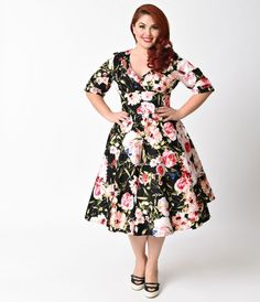 Let Delores get domestic with you, darling. A bewitching black dress rich in plus size 1950s vintage appeal fresh from Unique Vintage, Delores is unparalleled with a beautiful pink floral bouquet print! Boasting a gathered surplice v-neckline, trim and ta
