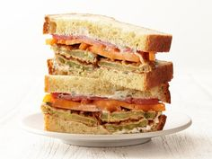 Fried Green Tomato Sandwiches : Pickled green tomatoes are the star of this sandwich. After frying them, layer the green tomatoes with yellow and red ones on thick bread for a colorful vegetarian-friendly dish.