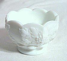 These are milk glass fruit cocktails made by Westmoreland. They measure 3.5 inches across by 2.75 inches high. They are marked with the W over G mark on the bot